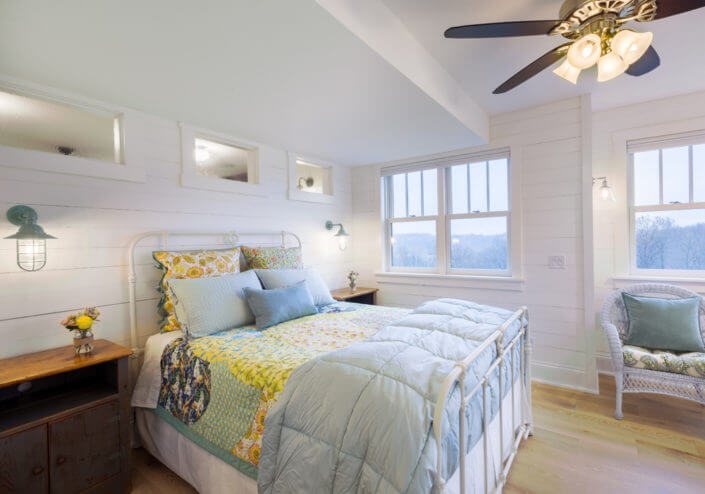 white bedroom with ship lap siding and arts and crafts style trim work