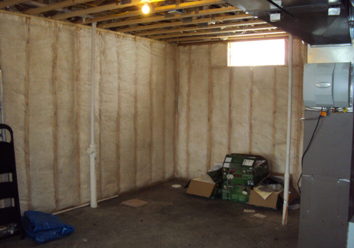 wall framing and insulation before basement finish