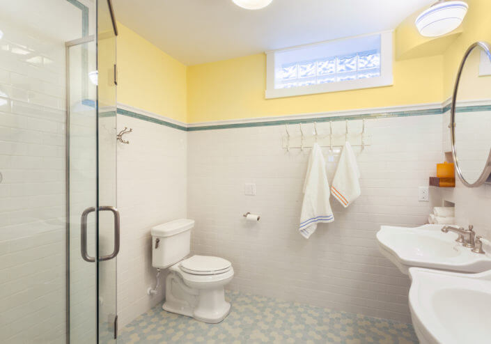 yellow and white bathroom remodel located in Madison WI