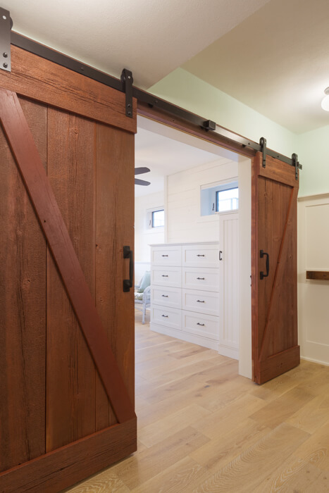 sliding rustic barn doors between bedroom and game room