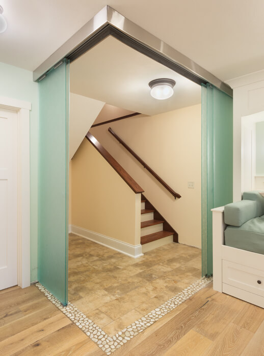arts and crafts basement with glass vestibule