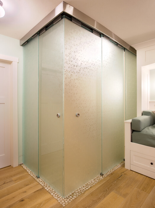 vestibule with frosted glass sliding doors