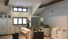 kitchen with beams and cabinets installed