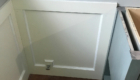 white wood wainscoting in bathroom