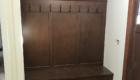 built in dark wood coat storage