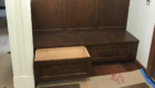 dark wood coat storage with drawer