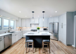 kitchen remodel with white cabinetry and gray island