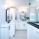 master bathroom with mosaic tile floor and white cabinetry