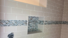 subway tile shower with accent band