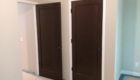 dark stained 1 panel doors with white trim
