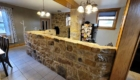kitchen with large stone wall